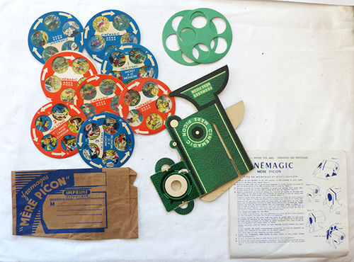 Small cardboard projector with films (50's)